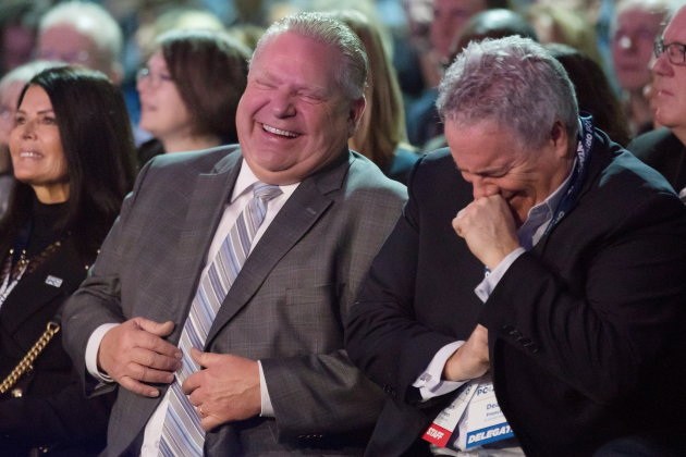 Ontario Premier Doug Ford, left, and Chief of Staff Dean French share a joke as they wait to hear Federal Conservative Leader Andrew Scheer speak at the Ontario PC Convention in Toronto on Saturday, November 17, 2018. THE CANADIAN PRESS/Chris Young