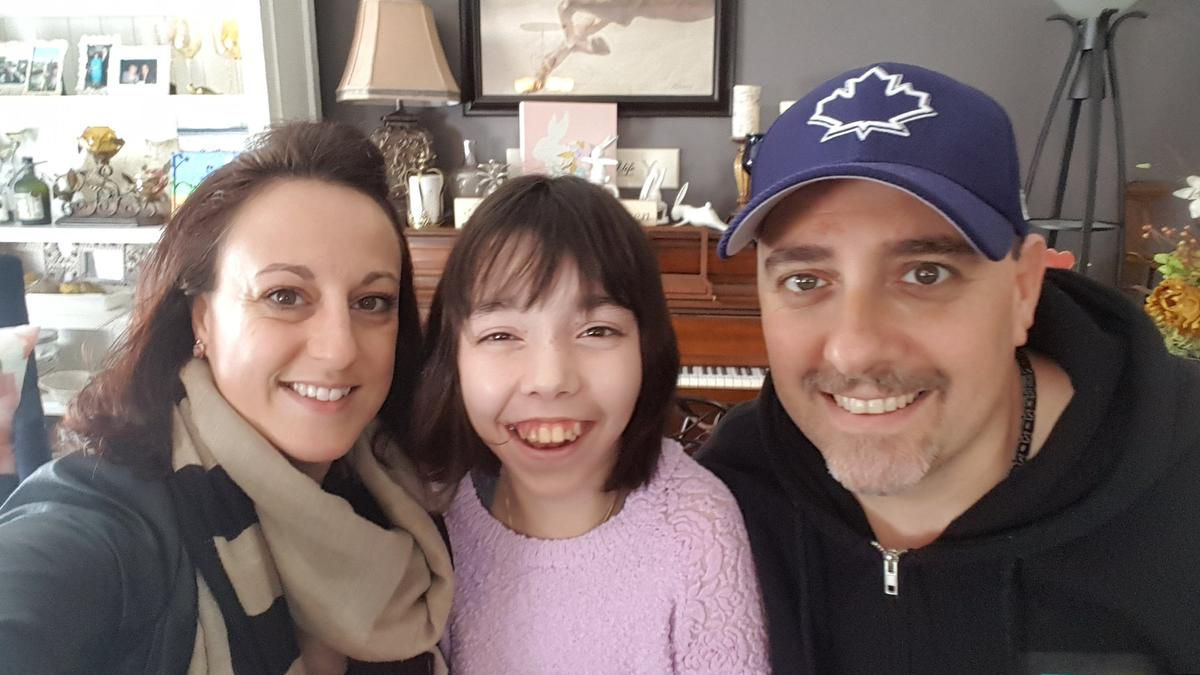 One of the class action lawsuits slated for dismissal, is that of Briana Leroux (middle), pictured here with her father Marc and stepmother Lisanne. Briana has a rare brain disorder, and lost her provincial developmental services funding when she turned 18 in February 2016. She has a mental age of about three, cannot speak, and lacks the most basic ability to care for herself. The lawsuit alleges that the Ontario government has been arbitrarily making thousands of mentally disabled people wait indefinitely for provincial government supports after they turn 18. Their case was finally certified as class action December 2018. —photo The Star